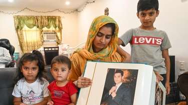 Hifsa Ahmad, 26, shows a picture of her