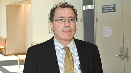 Dr. Michael Caplan, ex-chief medical examiner for Suffolk