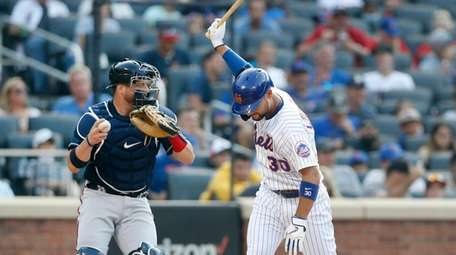 Michael Conforto #30 of the Mets reacts after