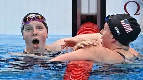 USA's Lydia Jacoby (L) celebrates winning with third-placed
