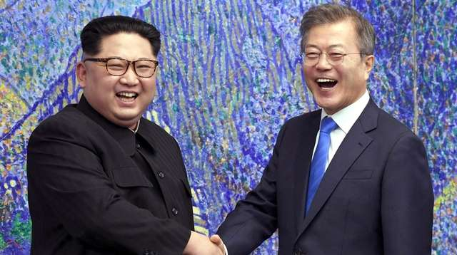 North Korean leader Kim Jong Un, left, poses