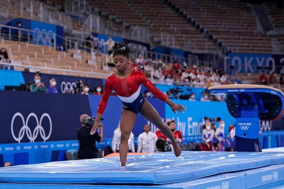 Simone Biles, of the United States, dismounts from