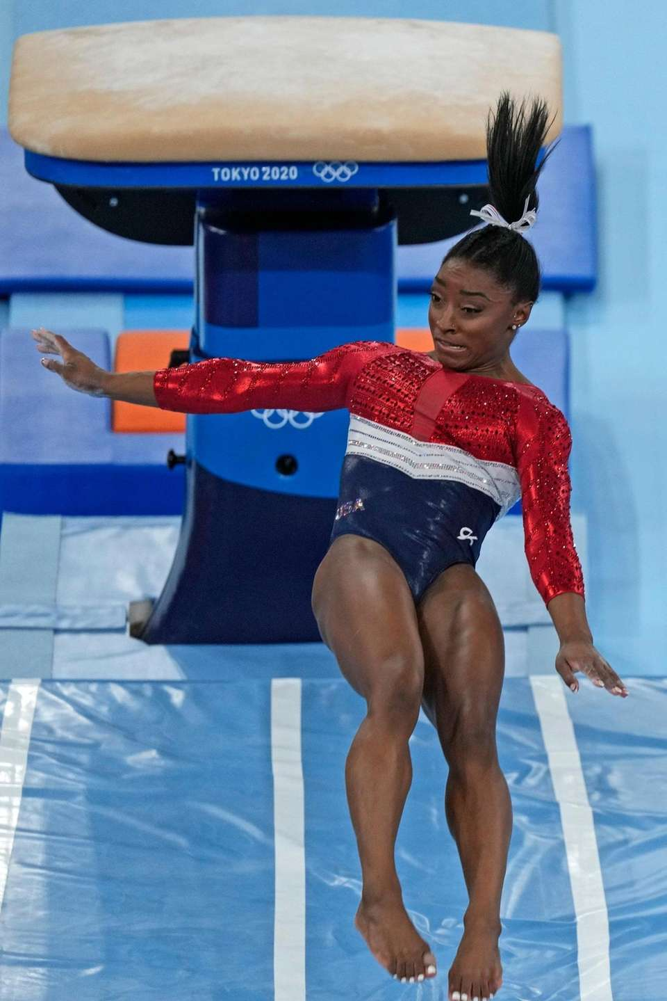Simone Biles, of the United States, performs on