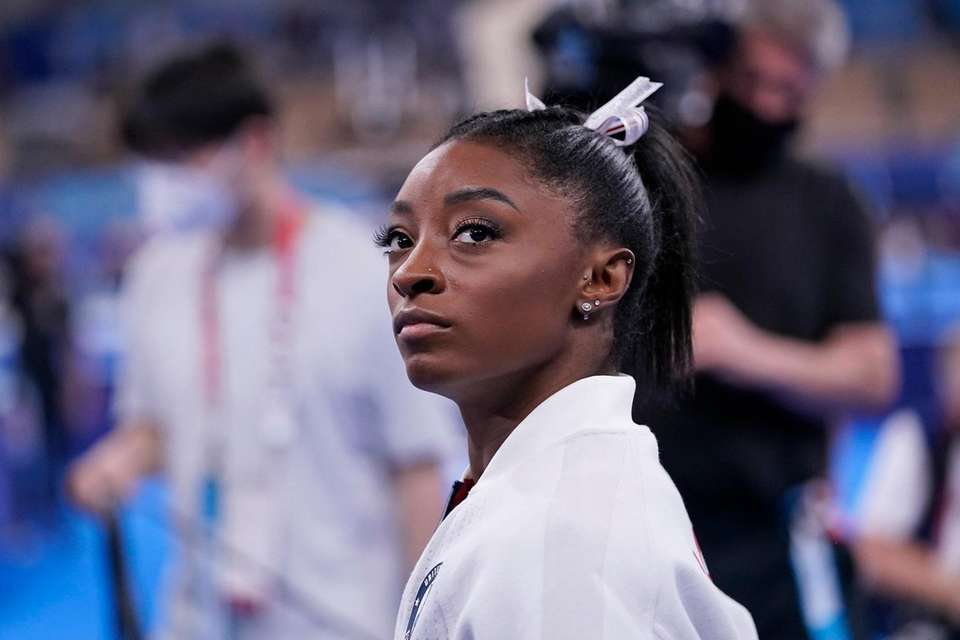 Simone Biles, of the United States, waits for