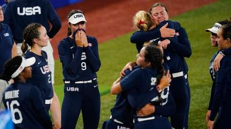 Members of team United States react after a