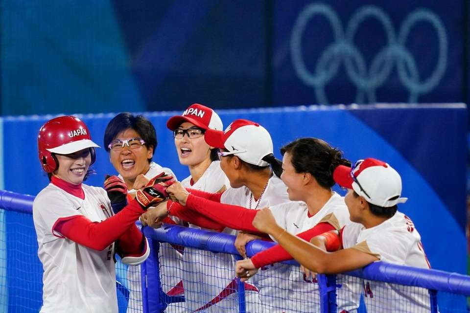 Japan's Saki Yamazaki celebrates her sacrifice bunt with