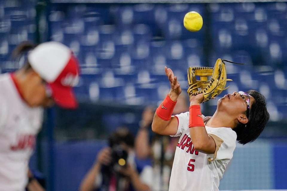 Japan's Yu Yamamoto catches a fly out during