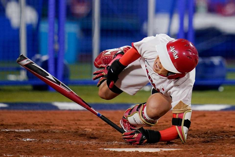 Japan's Nodoka Harada reacts after being hit while