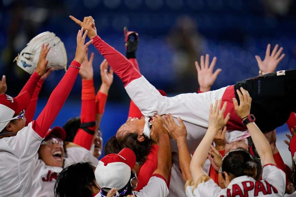 Members of team Japan celebrate after winning the
