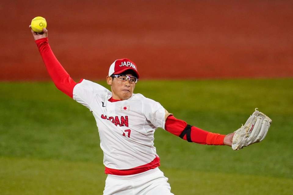 Japan's Yukiko Ueno pitches during the first inning
