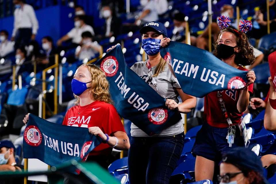 Fans of team United States cheer during a