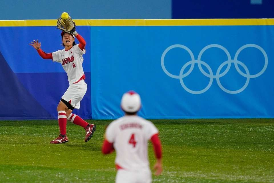 Japan's Nodoka Harada catches a fly out during