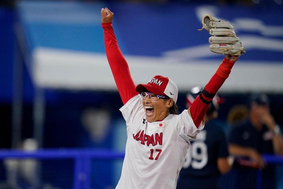 Japan's Yukiko Ueno celebrate after a softball game