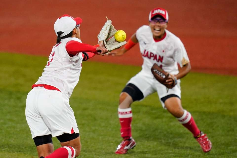 Japan's Yukiko Ueno, left, fields a ground out