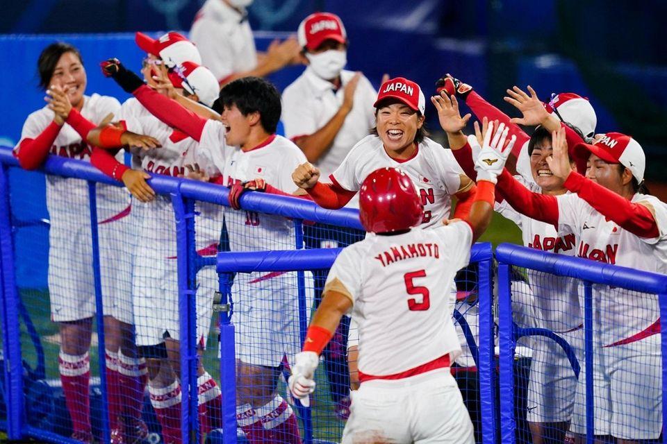 Japan's Yu Yamamoto (5) celebrate with teammates after