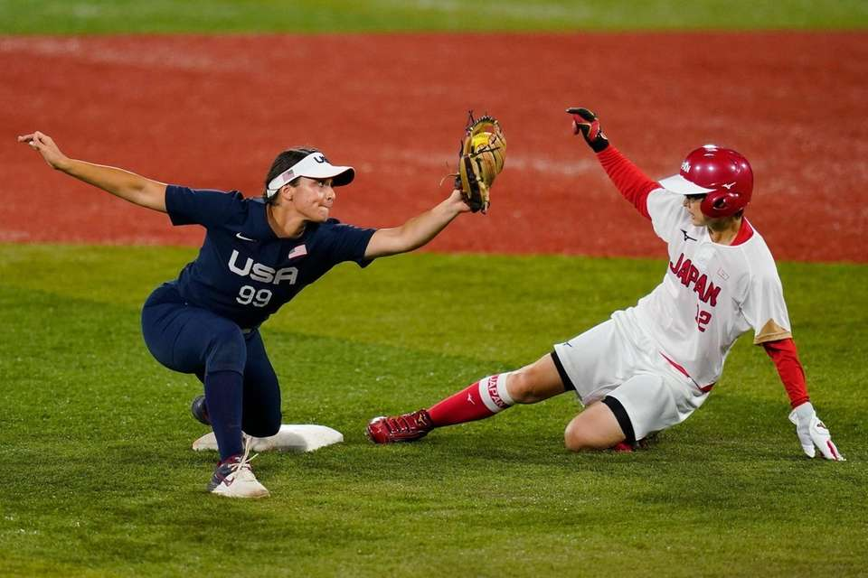 Japan's Mana Atsumi, right, is forced out by