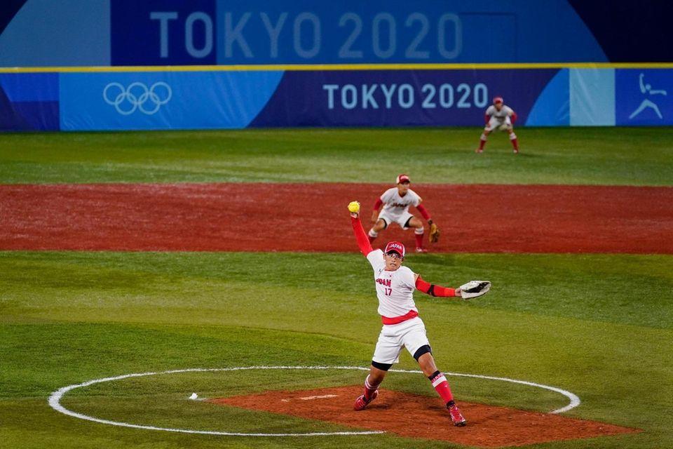 Japan's Yukiko Ueno pitches during a softball game