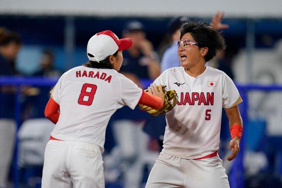 Japan's Nodoka Harada (8) and Yu Yamamoto celebrate