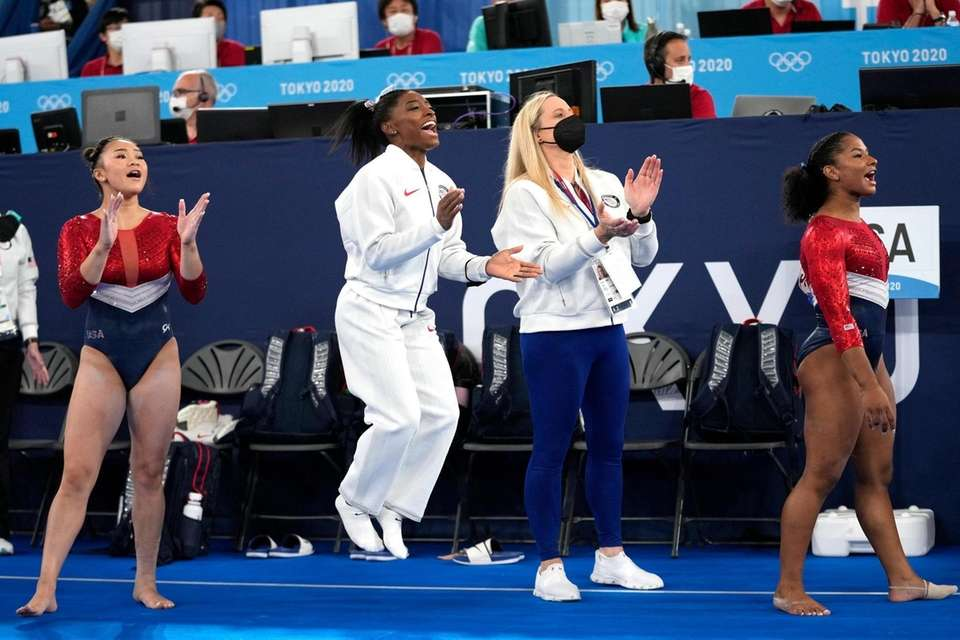 Gymnasts from the United States, Simone Biles, centre,