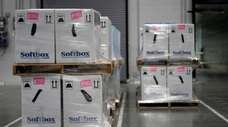 Boxes containing the Pfizer-BioNTech COVID-19 vaccine. Vaccines sitting