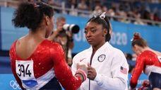 Simone Biles talks with Jordan Chiles of Team