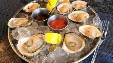 Local oysters and clams on the half-shell at