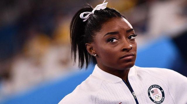 Simone Biles reacts during the artistic gymnastics women's