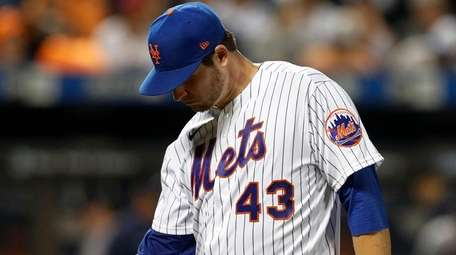 Jerad Eickhoff of the Mets walks to the