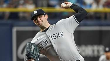 Yankees starter Jordan Montgomery pitches to a Rays