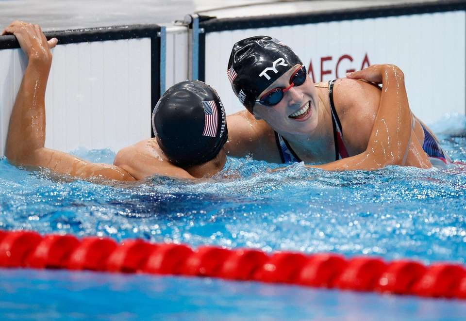 USA's Kathleen Ledecky (R) celebrates with USA's Erica