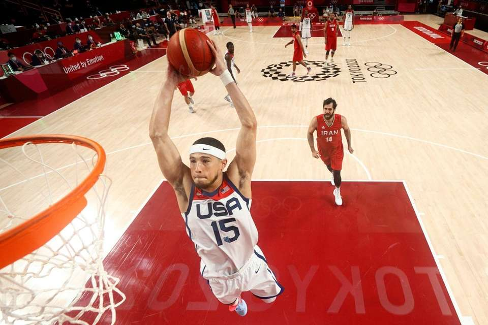 United States' Devin Booker (15) dunks the ball