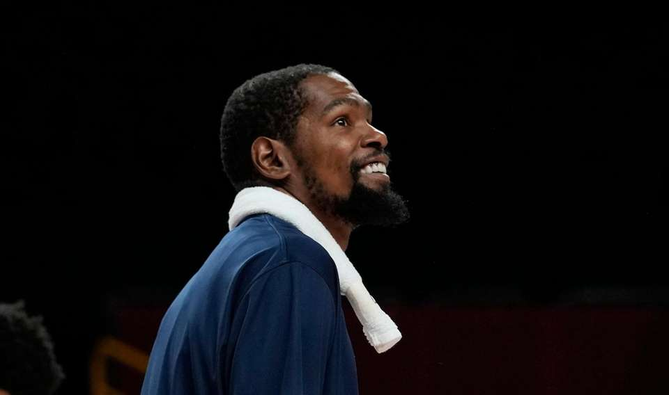 United States' Kevin Durant (7) smiles after their
