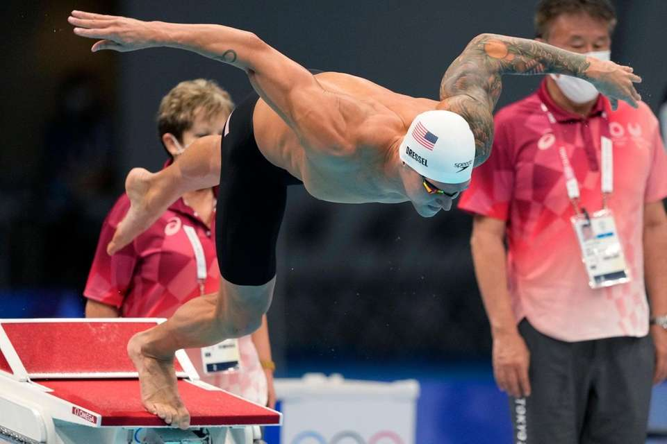 Caeleb Dressel of the United States starts in