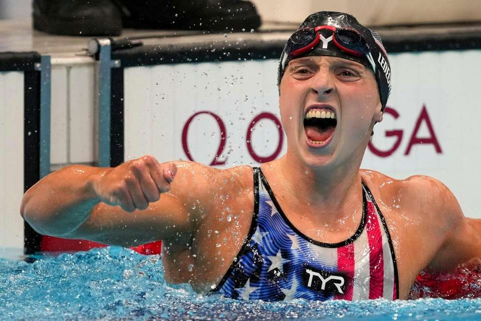 Katie Ledecky, of the United States, reacts after