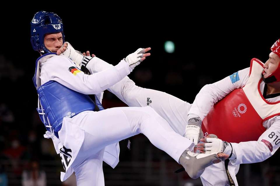 Alexander Bachmann (L) of Team Germany competes against