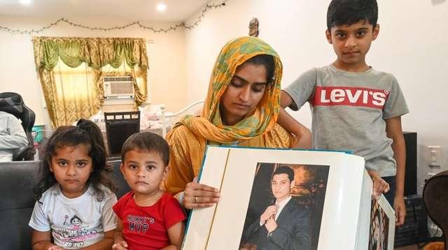 Hifsa Ahmad with a picture of her husband,