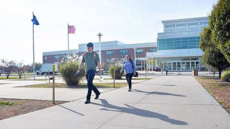 Students walk through the Brentwood campus of Suffolk
