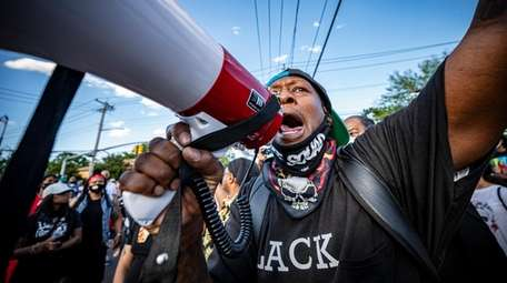 Demonstrators call for justice for George Floyd in