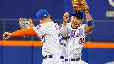 The Mets' Michael Conforto and Pete Alonso celebrate