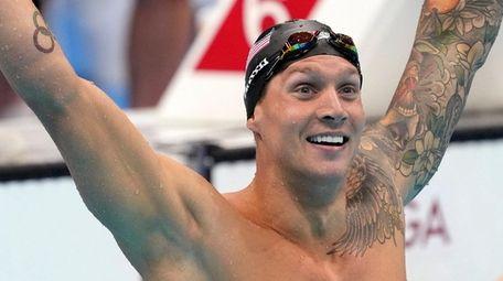 Caeleb Dressel of the United States celebrates winning