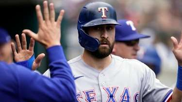 Rangers designated hitter Joey Gallo is greeted in