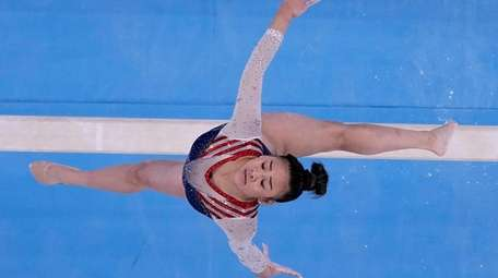 Sunisa Lee, of the United States, performs on