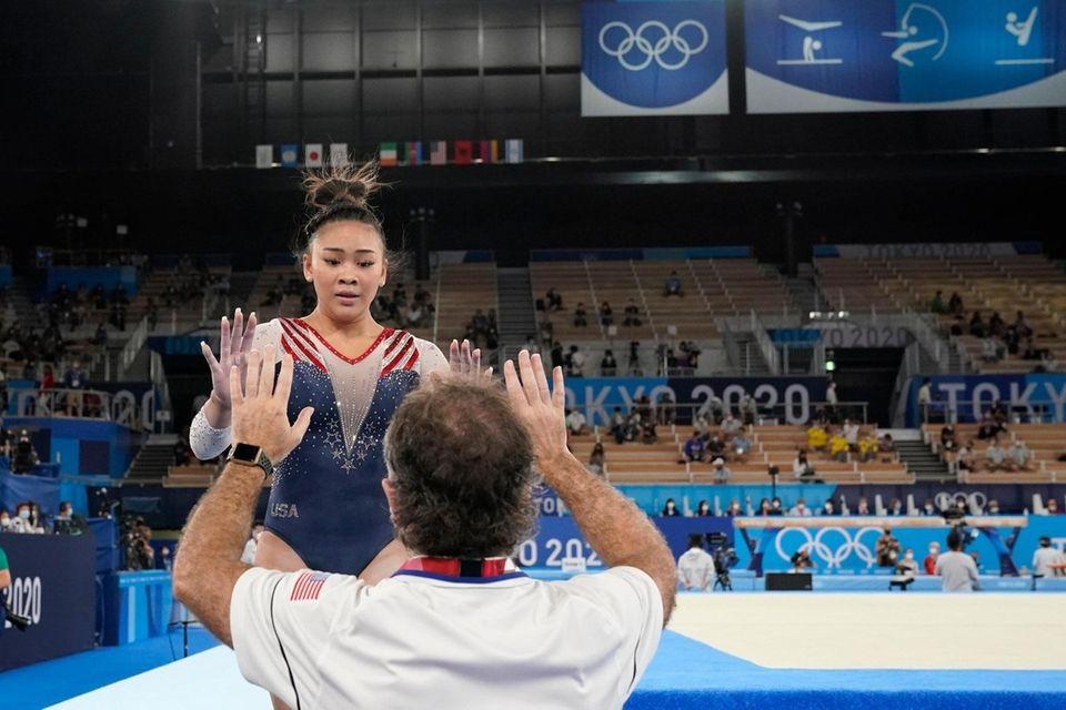 Sunisa Lee, of the United States, celebrates with