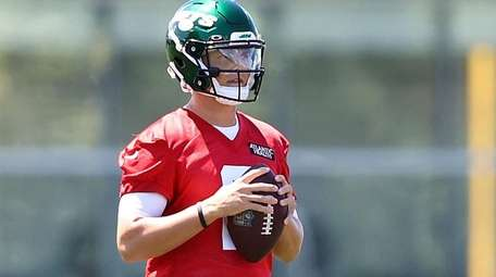 Zach Wilson #2 of the Jets runs drills