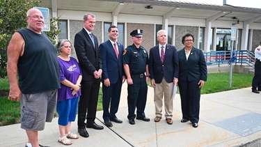 Suffolk County officials on Thursday recognized Police OfficerLucas