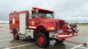 The 2001 International/Saulsbury hose wagon, which has 5,736