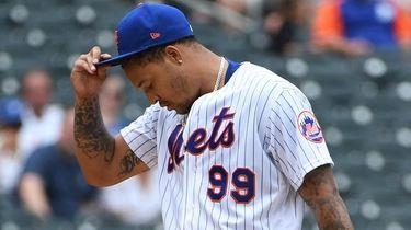 New York Mets starting pitcher Taijuan Walker reacts