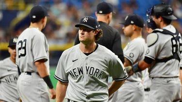 Gerrit Cole #45 of the Yankees walks to
