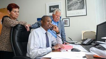 Darryl Johnson, admissions intake director, sitting, with JoAnn