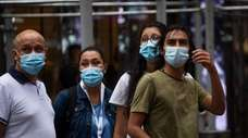 People wear a face masks in Manhattan on